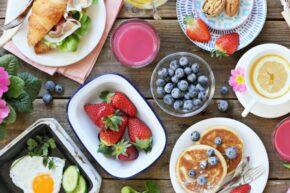 Healthy breakfast foods: fresh fruit, eggs, croissant, tea. Diet tips for IBD, Crohn's, ulcerative colitis.